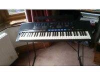 Yamaha PSR 47 electric keyboard. Good working order, cover and stand.