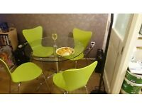 Glass topped and Chrome based dining table and chairs. Excellent condition.