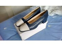 Pair of navy and cream Clarks shoes size 8.