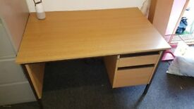 Wooden desk with 2 drawers. Big enough for computer and still plenty of space on the work surface.