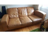 Two Tan Leather Sofas. Three seater and two seater. FREE