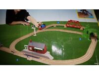 Two playsets with three battery operated trains.