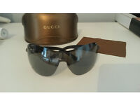 Genuine Gucci Sunglasses, with case and cleaning cloth.