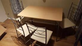 Table, chairs, chest of drawers