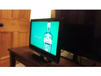 """24"""" LCD TV. Built in DVD. 'Neon'. 24"""" Widescreen. Freeview. HDMI. Good condition and sound."""