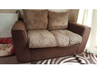 Faux leather 2 seater sofa in very good condition.