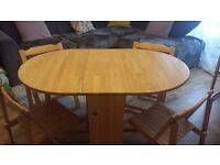 JOHN LEWIS BUTTERFLY FOLDING DINING TABLE AND CHAIRS.