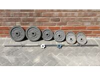 GOLDS GYM CAST IRON WEIGHTS SET WITH LONG BARBELL
