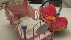 Baby Annabell with cot and toy car seat
