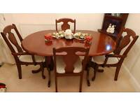 Mahogany extendable oval dining table
