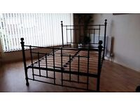 Black metal double bed. Very sturdy and in excellent condition.