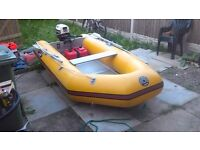 Pro Marine Inflatable Dinghy With 10 hp Honda 4 stroke outboard & fuel tank & launching wheels.
