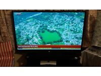 Sharp 60 Inch LCD TV with glass trolley