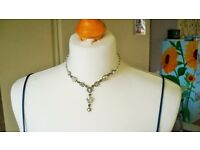 Costume choker silver necklace.