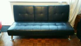 Black faux leather 4 seater sofa bed