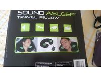 Sound asleep travel pillow with integral speakers.