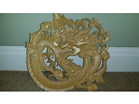 Solid wood hand carved Chinese dragon.