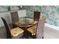 Round dining table glass top 4 chairs and cushions