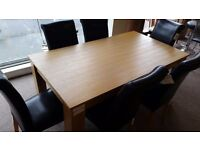 Excellent condition like new!!! Solid wooden dining table set with 6 leather chairs