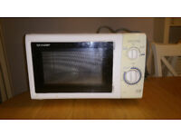 Sharp Microwave Oven, 800 Watts, White, model R-206, complete with rotating glass plate..