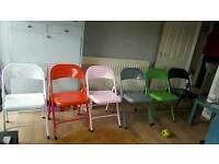 Folding metal chairs