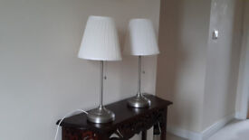 Two Brushed Chrome Lamps with Cream Pleated Shades