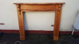 Mantle and mirror matching fireplace surround