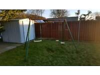 Swing set with one swing missing but can easily be repaired with new rope