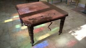 Extendable antique mahogany dining table.