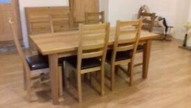 New solid oak dining table and chairs