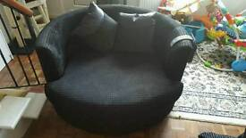 Black swivel cuddle chair