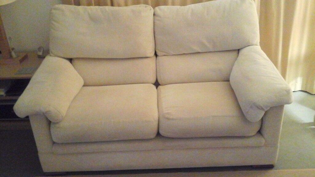 2 x 2-seater sofas +1 armchair. Cream fabric.