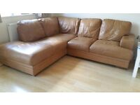 Two tan leather sofas. One right hand L shaped sofa with wooden feet and matching 2 seater sofa
