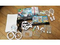 Nintendo Wii U 32GB with Mario Kart 8 + 3 Wii U & 12 Wii Games + Wii Fit Balance Board & more...