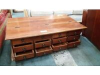 Hardwood coffee table with built in drawers and storage
