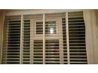 White wooden taped blinds