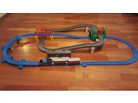 Tomy Thomas Road and Rail track with battery operated Thomas and carriages and push along bus
