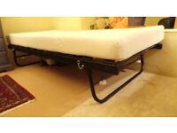 Black 3 foot wide 'trundle' bed.