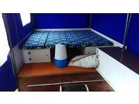 Folding trailer tent