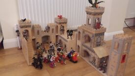 Nice wooden castle/fort with figures.
