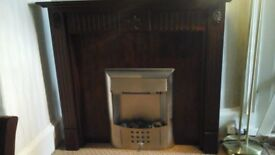 Dark wood fire surround.
