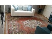 Large Chinese Rug and Beige Tub Chair, collection only