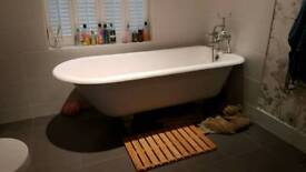 Roll top acrylic bath with taps