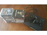 Sony playstation 3 120gb slim console, 2 controllers and 29 top games