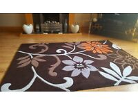 Brown irange and cream..as new..size 120 x 170