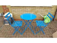 Colourful outdoor table and 2 chairs