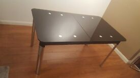 Beautiful black-chrome glass extendable dining table