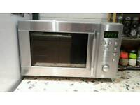 Silver microwave oven in box