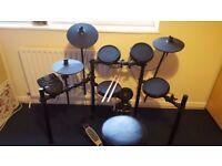 Alesis Nitro Electric Drum kit in excellent condition.