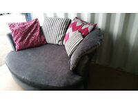 DFS CHARCOAL GREY 2 SEATER CUDDLE CHAIR FOR SALE.